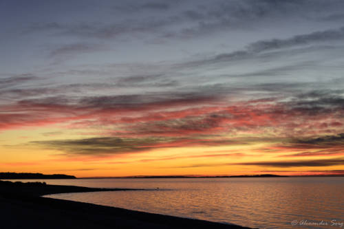 Farbenprächtiger Sonnenuntergang über dem Limfjord bei Løgstør